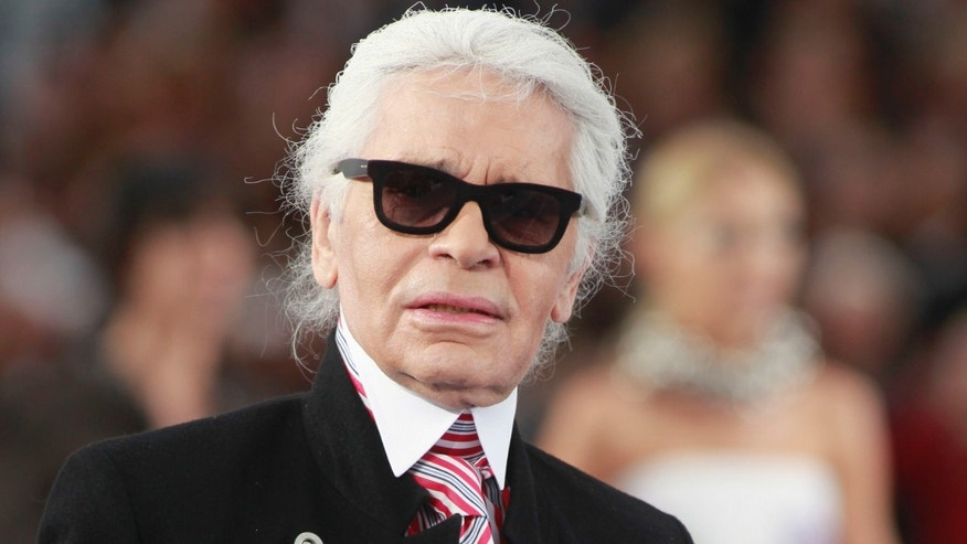 FILE - In this Oct.2, 2012 file photo, designer Karl Lagerfeld walks onto the runway after presenting Chanel's ready to wear Spring-Summer 2013 collection, presented in Paris.