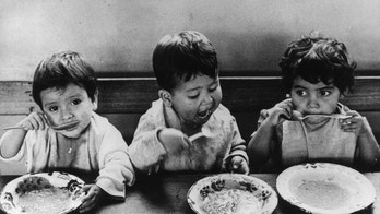 10th September 1970:  Three Guatemalan children eating food provided by a UNICEF aid program.  (Photo by Keystone/Getty Images)