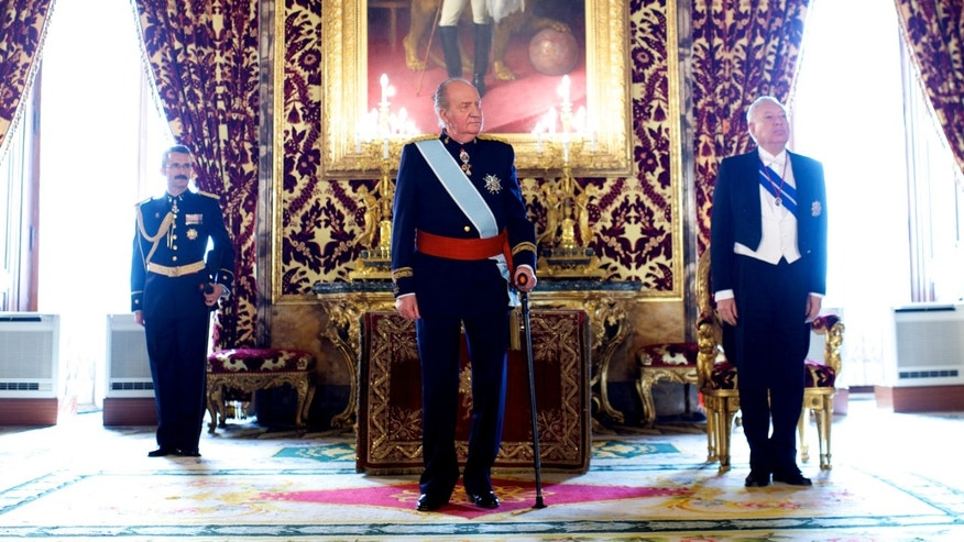 King Juan Carlos of Spain (C) receives new ambassadors at the Royal Palace on February 6, 2013 in Madrid, Spain.  (Photo by Carlos Alvarez/Getty Images)
