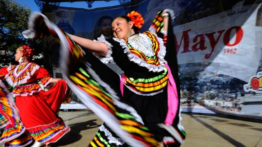 LOS ANGELES, CA - MAY 05:  Samantha Romero with Mexica Ballet Folclorico performs during Cinco De Mayo festivities on May 5, 2011 at El Pueblo de Los Angeles Historic Site on Olvera Street in downtown Los Angeles, California. Cinco de Mayo celebrates the 1862 Mexican victory over the French in the Battle of Puebla.  (Photo by Kevork Djansezian/Getty Images)