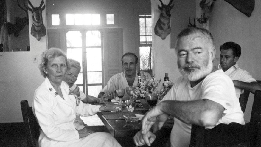 "Ernest Hemingway dines with Gianfranco Ivancich, right, an unidentified woman, left, Mary Hemingway, and Juan ""Sinsky"" Duñabeitia, at the Finca Vigia Hemingway in San Francisco de Paula, Cuba on an undated photograph provided by the Library and Museum John F. Kennedy of Boston."