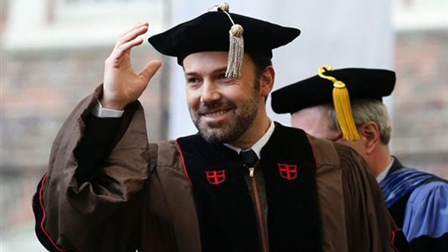 Ben Affleck gestures before receiving an honorary degree at Brown University's 245th commencement in Providence, R.I., Sunday, May 26, 2013.