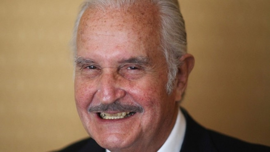 FILE - In this March 12, 2012 file photo, Mexican author Carlos Fuentes poses for a photo after a press conference in Mexico City.  FBI documents, posted on their website Thursday, June 20, 2013, show that the bureau and the U.S. State Department kept close track of Fuentes, considered a Communist and sympathizer of Cuba's Fidel Castro. The United States denied Fuentes an entry visa at least twice in the 1960s. He died on May 15, 2012. (AP Photo/Alexandre Meneghini, File)