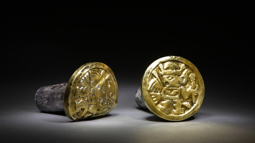 This undated photo released by the National Geographic Society shows a pair of gold-and-silver ear ornaments that archaeologists believe a high-ranking Wari woman wore to her grave, the imperial tomb at El Castillo funerary complex, where they also discovered the remains of 63 individuals, including three Wari queens in Huarmey, Peru. A team of Polish and Peruvian archaeologists lifted more than 30 tons of crushed stone to find a pre-Inca royal tomb containing 63 mummies belonging to the ancient Wari culture, accompanied by an impressive wardrobe of 1,200 gold ornamental pieces, silver and ceramics. The Wari forged South Americas earliest empire between A.D. 700 and 1000. (AP Photo/National Geographic Society, Daniel Giannoni)