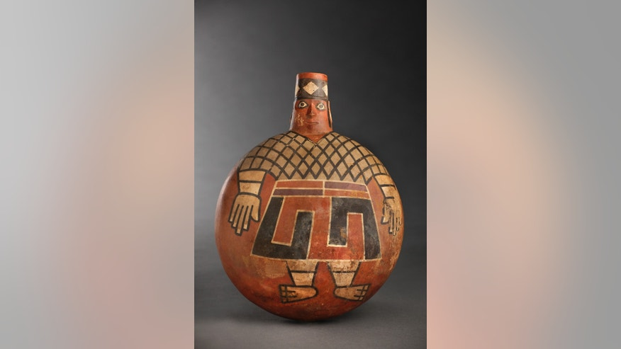In this undated photo released by the National Geographic Society, a Wari lord painted with eyes wide open, stares out from the side of a 1,200-year-old ceramic flask found in a newly discovered tomb at El Castillo funerary complex, Huarmey, Peru. A team of Polish and Peruvian archaeologists lifted more than 30 tons of crushed stone to find a pre-Inca royal tomb containing 63 mummies belonging to the ancient Wari culture, accompanied by an impressive wardrobe of 1,200 gold ornamental pieces, silver and ceramics. The Wari forged South Americas earliest empire between A.D. 700 and 1000. (AP Photo/National Geographic Society, Daniel Giannoni)