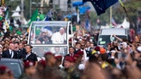 RIO DE JANEIRO, BRAZIL - JULY 28: Pope Francis waves from the Popemobile as he arrives to celebrate Mass on Copacabana Beach during World Youth Day celebrations on July 28, 2013 in Rio de Janeiro, Brazil. More than 1.5 million pilgrims are expected to join the pontiff for his visit to the Catholic Church's World Youth Day celebrations which is running July 23-28.  (Photo by Buda Mendes/Getty Images)