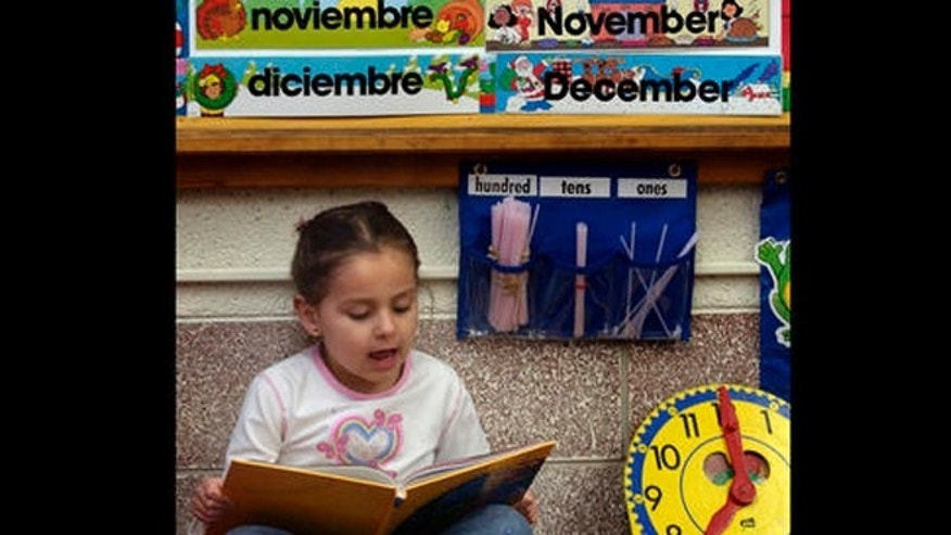 Kasandra Herrera, 6, reads a book in Spanish in Bianca Alvarez's dual language first grade classroom at Northwest Elementary School in Dodge City, Kan. Feb. 22, 2005. The Dodge City district has the highest bilingual enrollment in the state seeing a dramatic increase in the town's Hispanic population in the past ten years. Funding for bilingual related programs is set to increase next year in both House and Senate school finance proposals as lawmakers strive to meet a Supreme Court deadline of April 12 to increase school funding. (AP Photo/Charlie Riedel)