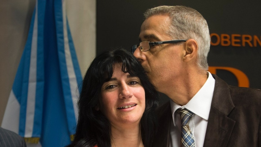 Cesar Cigliutti, president of the Argentine Homosexual Community, and Gabriela Mansilla, Luana's mother, during a news conference in Buenos Aires, Argentina, Wednesday, Oct. 9, 2013.