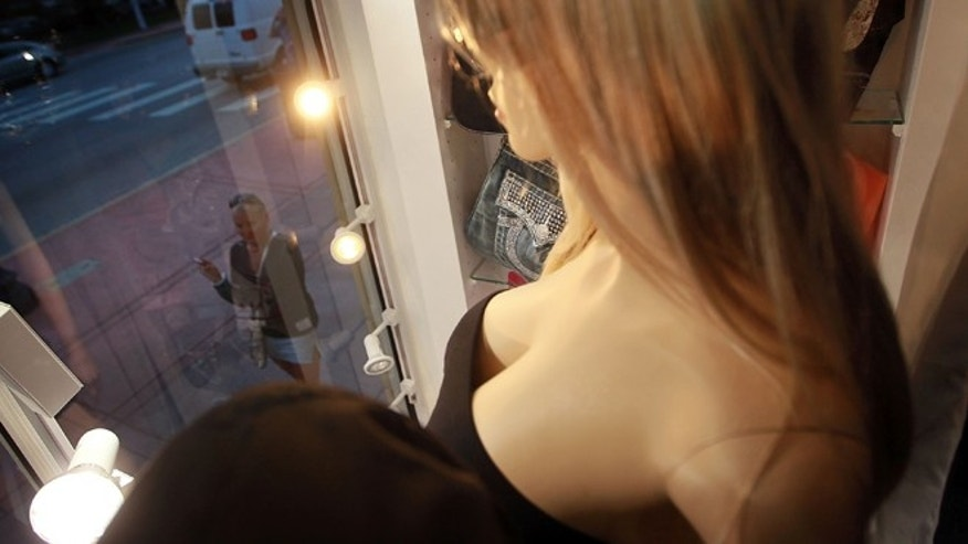 MIAMI BEACH, FL - APRIL 26:  A mannequin that sports extra large breasts is seen in the display window of the Ocean 9ine store on April 26, 2010 in Miami Beach, Florida. A recent phenomenon in curvy mannequins is thought to be a reflection in the number of women who now have plastic surgery as well as catering to men's fondness for large boobs.  (Photo by Joe Raedle/Getty Images)
