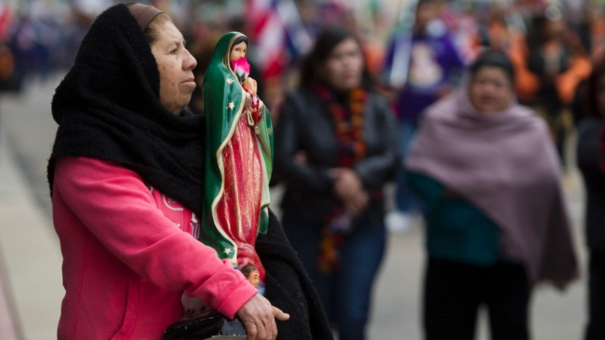 Feast of Our Lady of Guadalupe procession on Sunday, Dec. 8, 2013, in Houston.
