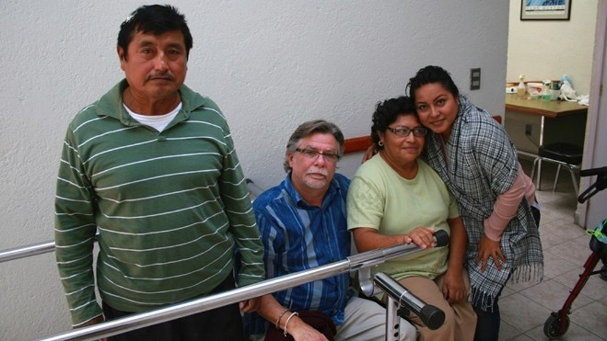John Reynolds (second from left), a prosthetist from Tennessee, recently returned for a medical mission to Mexico. Here, he is joined by a husband and wife who are both above-the-knee amputees and their daughter. (Photo Courtesy of John Reynolds)