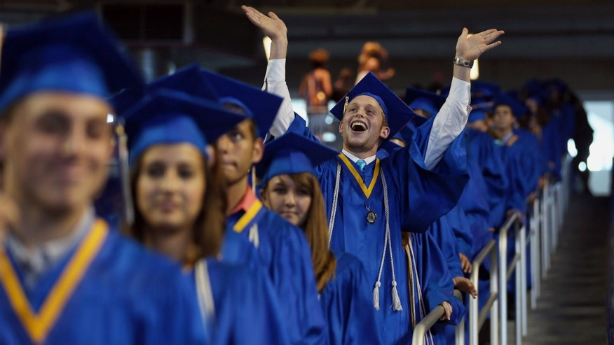 MIAMI, FL - JUNE 04: Yoel Lapsher and other graduates arrive for the graduation ceremony were Vice President Joe Biden spoke during the commencement ceremony for Cypress Bay High School graduates at Marlins Park on June 4, 2012 in Miami, Florida. With Florida being an important swing state in the national election both Biden and President Barack Obama along with the Republican challengers are expected to make more campaign appearances before voters head to the polls in November.  (Photo by Joe Raedle/Getty Images)