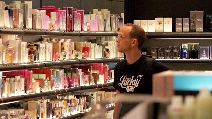 "SAN FRANCISCO - AUGUST 11:  A man browses fragrances at a Sephora cosmetics store in the international terminal at San Francisco International Airport August 11, 2006 in San Francisco, California. Businesses at airports are bracing for a financial hit after the Transportation Security Administration imposed a ban on all liquids and gels aboard flights as part of the Department of Homeland Security raising the terrorism threat alert to highest level of ""red"" on August 10, for commercial flights from Britain to the United States.  (Photo by Justin Sullivan/Getty Images)"