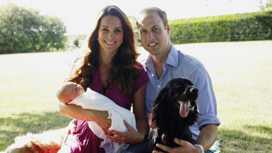 The royal couple with their son, Prince George in August 2013 in Bucklebury, Berkshire.