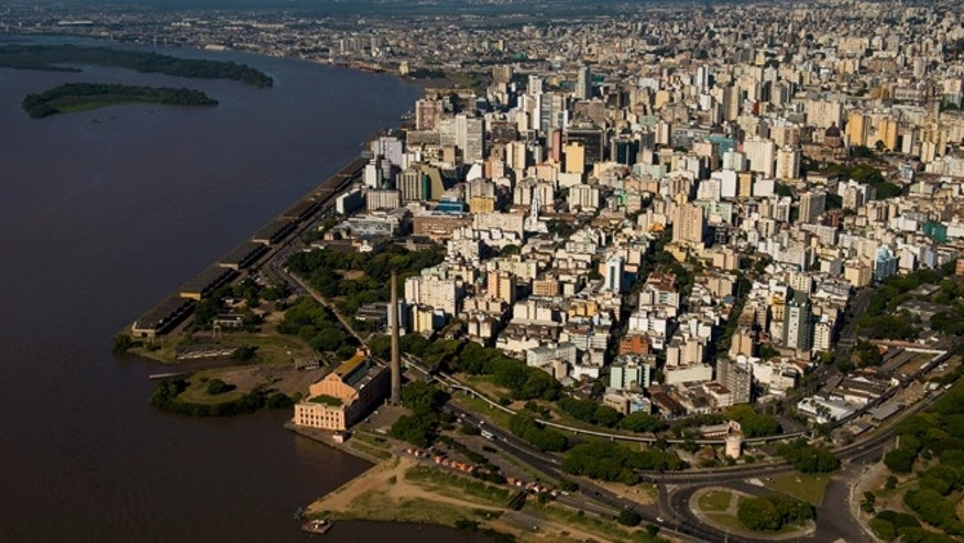 PORTO ALEGRE, BRAZIL - NOVEMBER 19:  An aerial view of the city, located the shores of the Guaiba Lake, on November 19, 2013 in Porto Alegre, Brazil. The Arena Beira Rio will be a stadium venue during the forthcoming FIFA 2014 World Cup Brazil. (Photo by Buda Mendes/Getty Images)