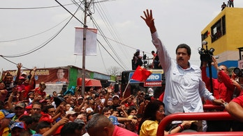 "Venezuela's interim President Nicolas Maduro waves to supporters from the top of a vehicle as he campaigns in a caravan from Sabaneta to Barinas, in Sabaneta, Venezuela, Tuesday, April 2, 2013. A former union leader and bus driver, Maduro is competing against opposition leader Henrique Capriles in the April 14 presidential election.  Invoking the late President Hugo Chavez during a televised speech on Tuesday, Maduro declared: ""This victory will belong to our commander!"" (AP Photo/Ariana Cubillos)"