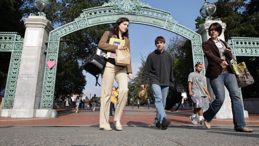 File - In this Dec. 14, 2011 file photo, University of California Berkeley students walk through Sather Gate on the campus in Berkeley, Calif. More Latino than white students in California have been offered admission to the state's premier public universities for the first time, officials said Friday, a milestone that reflects the diverse racial makeup of a state where Latino children represent a majority of students in public schools. (AP Photo/Paul Sakuma, file)