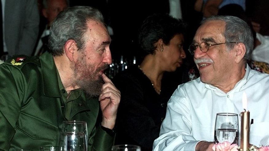 FILE - In this March 3, 2000 file photo, Cuba's leader Fidel Castro, left, and Colombian Nobel laureate Gabriel Garcia Marquez speak during a dinner at the annual cigar festival in Havana, Cuba. Marquez died on Thursday, April 17, 2014 at his home in Mexico City. (AP Photo/Jose Goitia, File)