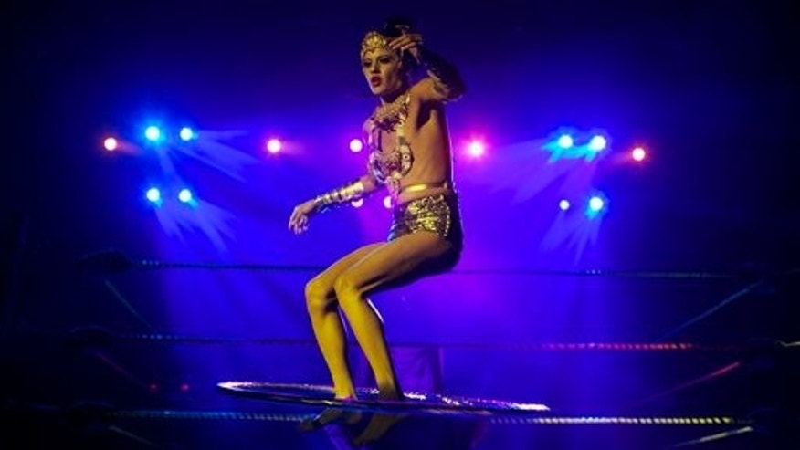 In this Wednesday, Feb. 12, 2014 photo, burlesque dancer Karis Wilde, a male dancer who performs in drag, performs  at Lucha VaVoom's Valentines show at The Mayan Theatre downtown Los Angeles. (AP Photo/Damian Dovarganes)