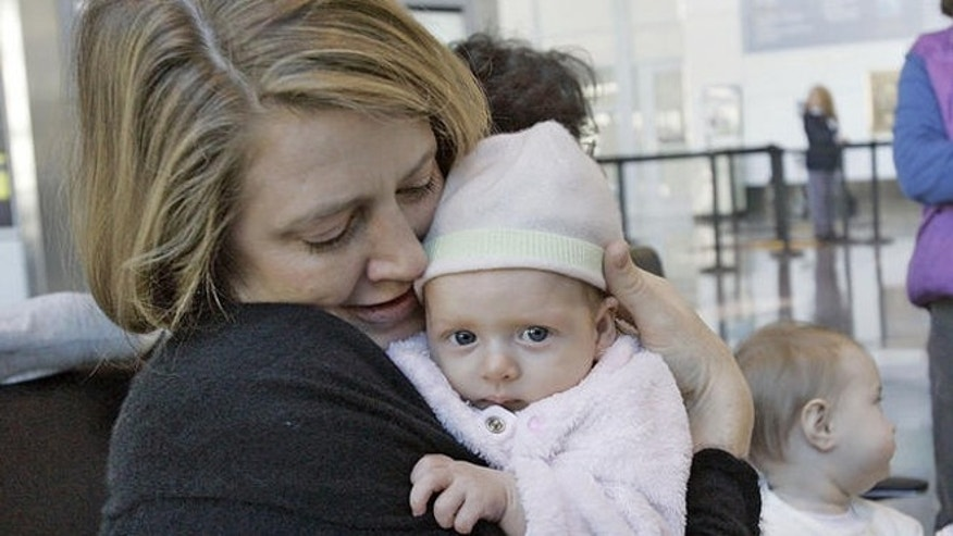 Lissa Pierce Bonifaz , left, of Boston, holds her 11-week-old baby, Marisol,  during a breast-feeding rally near the Delta Airlines ticket counter at Logan International Airport in Boston, Tuesday, Nov. 21, 2006, as Alison Yaker, of Somerville, Mass., holds her 6 month-old son, Charlie. At center is Ruth Leib, 8 month-old, who attended the rally with her mother Joan, not seen.  Mothers were there to protest the removal of a nursing mother from a Delta Airlines commuter flight in Burlington, Vt. (AP Photo/Chitose Suzuki)