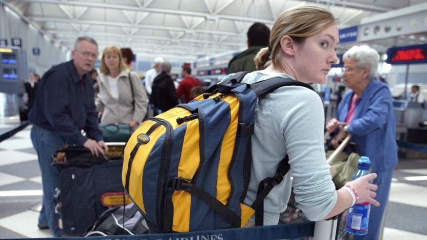 CHICAGO, IL - MAY 21:  Travelers stand in line at the United Airlines Terminal at O'Hare International Airport May 21, 2003 in Chicago, Illinois. The airlines said that it is weighing whether to emerge from bankruptcy months ahead of schedule. Analysts say the company has obstacles to overcome before it can operate outside of court protection.  (Photo by Tim Boyle/Getty Images)