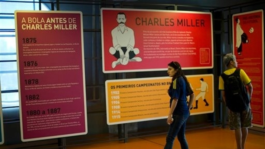 In this June 12, 2014 photo, visitors walk in the exhibit room dedicated to Charles Miller at the Soccer Museum in Sao Paulo, Brazil. Miller, born in Sao Paulo, Brazil and schooled in England, is hailed as the forefather of Brazilian football because he is widely credited as having organized the first proper game of football according to rules first drawn up in a London. (AP Photo/Dario Lopez-Mills)