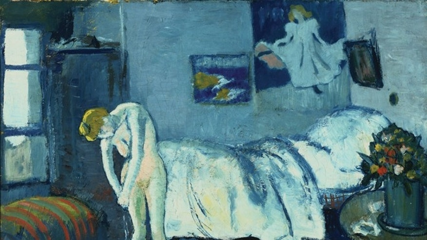 This undated handout image provided by The Phillips Collection shows Picassoâs The Blue Room, painted in 1901. Scientists and art experts have found a hidden painting beneath the painting. Advances in infrared imagery reveal a bow-tied man with his face resting on his hand, with three rings on his fingers. Now the question that conservators at The Phillips Collection in Washington hope to answer is simply: Who is he? Itâs a mystery thatâs fueling new research about the 1901 painting created early in Picassoâs career while he was working in Paris at the start of his distinctive blue period of melancholy subjects.(AP Photo/The Phillips Collection)