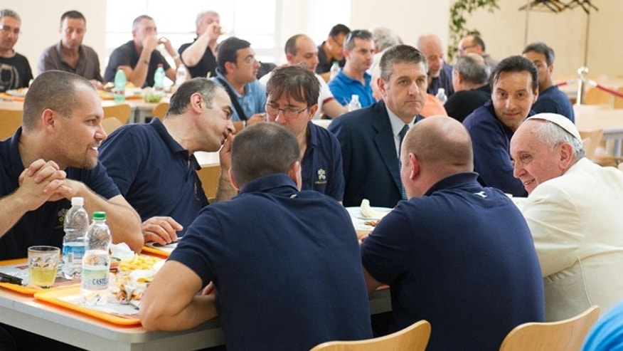 "In this photo provided by the Vatican newspaper L'Osservatore Romano, Pope Francis, bottom right, has lunch at the Vatican workers' cafeteria, Friday, July 25, 2014. Pope Francis got a free meal on Friday when he popped in unannounced at the Vatican workers' cafeteria and lined up, tray in hand, along with stunned diners. Cashier Claudia Di Giacomo told Vatican newspaper L'Osservatore Romano that when Francis presented his tray with a plate of cod fish, a bowl of fusilli pasta without sauce, a side of grilled tomatoes and ""just a few"" french fries she ""didn't have the courage to hand him the bill."" Francis chatted with his tablemates five Vatican pharmacy stock clerks. His tip? A papal blessing and photos snapped with diners, said the cafeteria chef, Franco Paini. The pope usually dines at the Vatican guest house where he lives. (AP Photo/L'Osservatore Romano)"