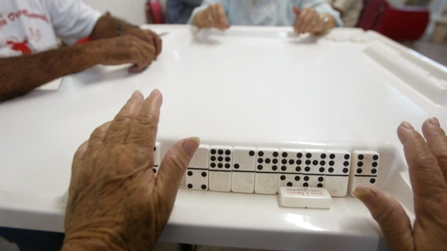 MIAMI - MAY 29:  Sofia Rodriquez prepares her hand during a game of dominoes  May 29, 2003 at a community center Miami, Florida. She is part of the largest and fastest growing minority in the U.S. According to the US Census Bureau, there are 37 million Hispanics, compared with 36.2 million African-Americans, and their numbers are expected to grow to 44 million in ten years. In Miami, Hispanics make up 60 percent of the population.   (Photo by Joe Raedle/Getty Images)