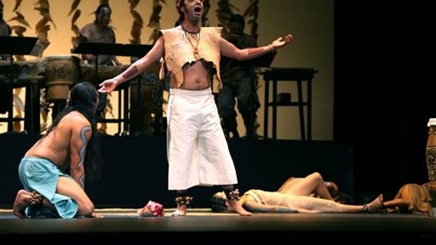 "CORRECTS SPELLING OF DIAZ - Actor Ricardo Diaz Mendoza, playing the part of Tohuenyo, on his knees left, and actor Cesar Juarez Joyner, who plays the part of Xochipilli, center, perform for members of the media the opera ""Xochicuicatl cuecuechtli"" in the Nahuatl language in Mexico City, Friday, Sept. 5, 2014. The Nahuatl title translates roughly as ""flowery song of mischief,"" and references sex as an analogy of life: intense, spirited and fleeting. The show premieres on Saturday in the Mexican capital. (AP Photo/Marco Ugarte)"