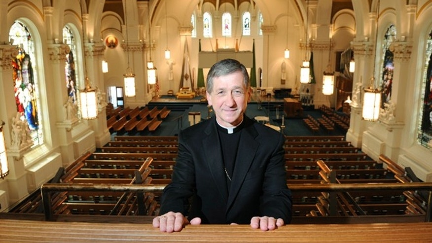 FILE - In this June 30, 2010, file photo, Bishop Blase Cupich, 61, of Rapid City, S.D., poses for a photo at The Cathedral of Our Lady of Lourdes after his announcement in Spokane, Wash. Cupich will be named the next archbishop of Chicago, The Associated Press has learned. Cupich will succeed Cardinal Francis George, according to a person with knowledge of the selection, who spoke Friday, Sept. 19, 2014, on the condition of anonymity because the person wasn't authorized to speak publicly. (AP Photo/The Spokesman-Review, Dan Pelle)