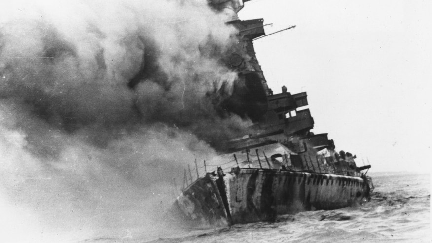 17th December 1939:  The German battleship Graf Spee sinks in the Harbour at Montevideo. It was scuttled by the German forces.  (Photo by Central Press/Getty Images)