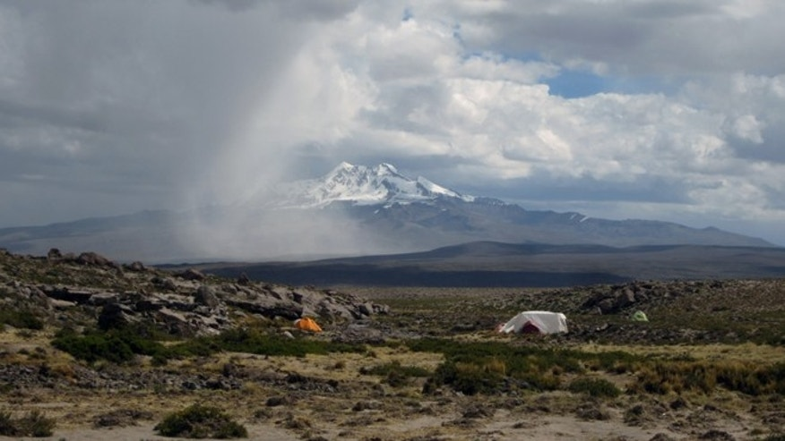 This undated image provided by journal Science shows a campsite in Pucuncho Basin. Stone tools and other artifacts have revealed the presence of hunter-gatherers at about 14,700 feet above sea level, between 12,000 and 12,500 years ago in the Peruvian Andes. (AP Photo/Science, Matthew Koehler)