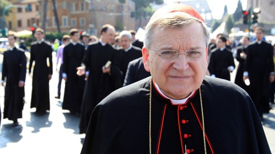 FILE - This May 13, 2012 file photo shows Cardinal Raymond Leo Burke, of the United States, taking part in an anti-abortion march in Rome. American Cardinal Raymond Burke, a fervent opponent of abortion and gay marriage, was removed by Pope Francis from another top Vatican post on Saturday. The removal of Burke as head of the Holy See's supreme court was widely expected in church circles. (AP Photo/Riccardo De Luca, File)