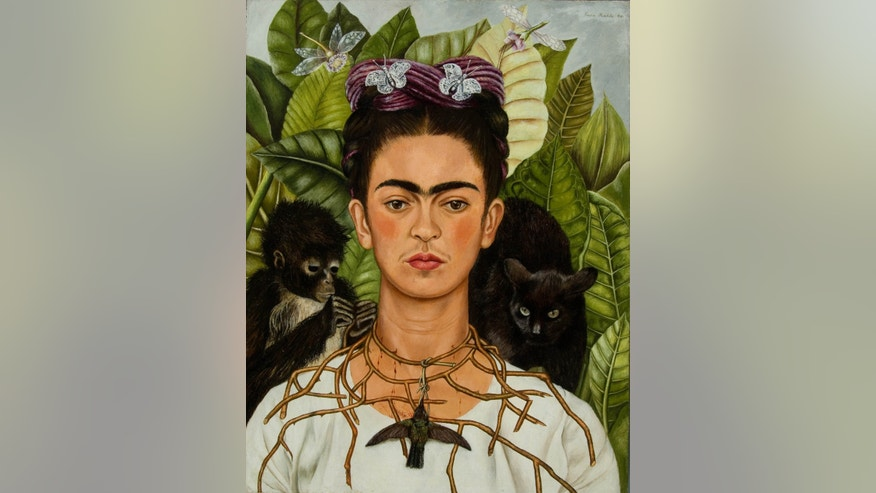 This undated photo provided by the New York Botanical Garden, a 1940 painting entitled Self-Portrait with Thorn Necklace and Hummingbird, by Frida Kahlo is shown. The painting will join more than a dozen works by the artist at an exhibition at the New York Botanical Garden in the Bronx borough of New York. The exhibition runs from May 16 to Nov. 1, 2015. (AP Photo/Frida Kahlo via The New York Botanical Garden)