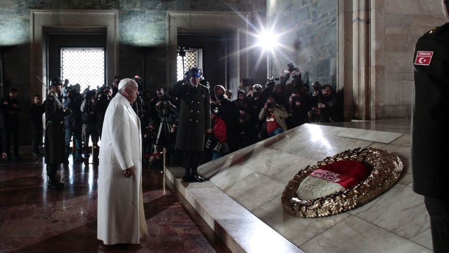Pope Francis pauses after laying a wreath at the grave site of  the Turkish republic founder, Mustafa Kemal Ataturk, inside the Ataturk Mausoleum in Ankara, Friday, Nov. 28, 2014. Pope Francis arrived in Turkey on Friday at a sensitive moment for the Muslim nation, as it cares for 1.6 million refugees and weighs how to deal with the Islamic State group as its fighters grab chunks of Syria and Iraq across Turkey's southern border.  (AP Photo/Markus Schreiber)