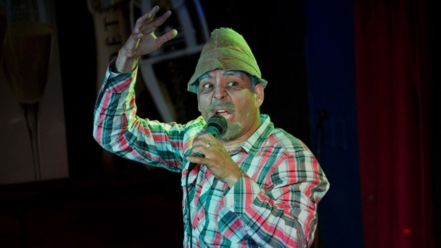 "Cuban actor Luis Silva whose stage name is ""Panfilo"" performs in front of  the public in Havana, Cuba, Monday, Dec. 8, 2014. The comedian's jokes resonate deeply with Cubans frustrated by petty corruption, scarcity of many goods, and the poor quality of even the most basic staples. (AP Photo/Desmond Boylan)"