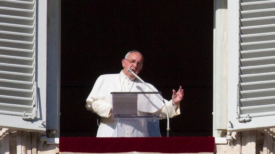 Pope Francis speaks during the Angelus noon prayer from his studio window overlooking St. Peter's square at the Vatican, Sunday, Jan. 4, 2015. Pope Francis named 15 new cardinals Sunday, selecting them from 14 nations, including far-flung corners of the world such as Tonga, New Zealand, Cape Verde and Myanmar, to reflect the diversity of the church and its growth in places like Asia and Africa.  (AP Photo/Riccardo De Luca)