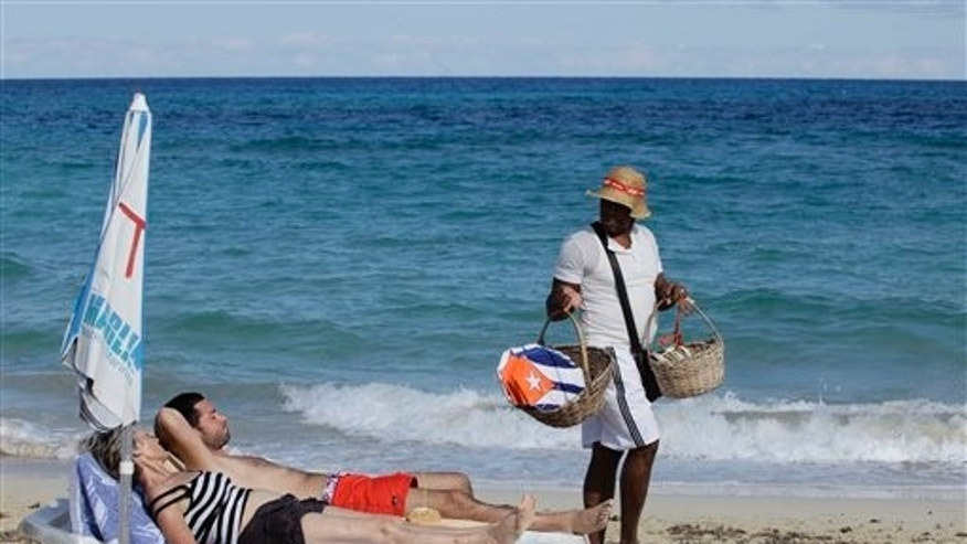 Tourists on a beach near Havana, Cuba.