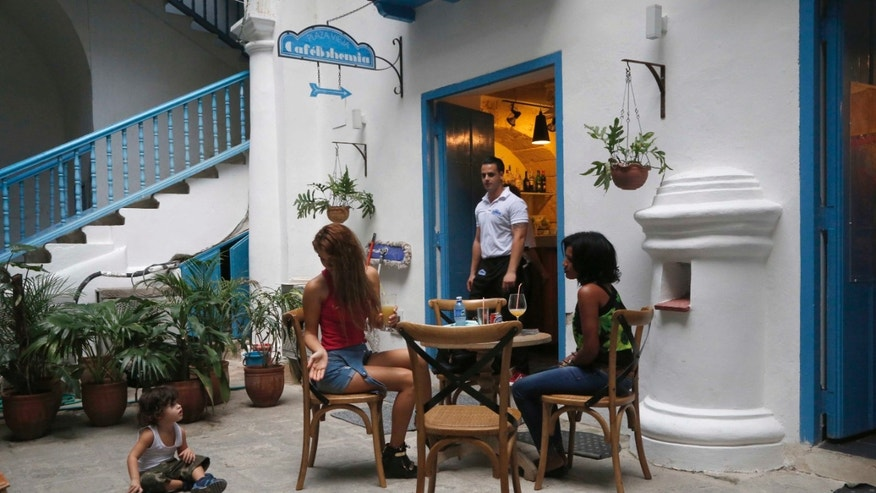 A cafe in a private residence in Havana, Cuba. Such cafes have become popular among tourists.