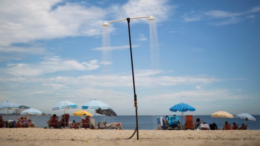A shower runs continuously on Leblon beach in Rio de Janeiro, Brazil, Wednesday, March 11, 2015. A historic drought making taps run dry across southeastern Brazil, particularly in South Americaâs largest city of Sao Paulo, has people worried they might be asked to cut down on their beloved showers. (AP Photo/Felipe Dana)