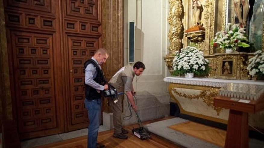 MADRID, SPAIN - Researchers search for the remains of writer Miguel de Cervantes' at Convento de las Trinitarias Descalzas on April 28, 2014 in Madrid, Spain. The author of 'Don Quijote de la Mancha' Miguel de Cervantes was born in 1547 and died in 1616. Investigators today began their search for Cervantes' burial site at 'Las Trinitarias Delcalzas' convent using GPR and infrared technology.