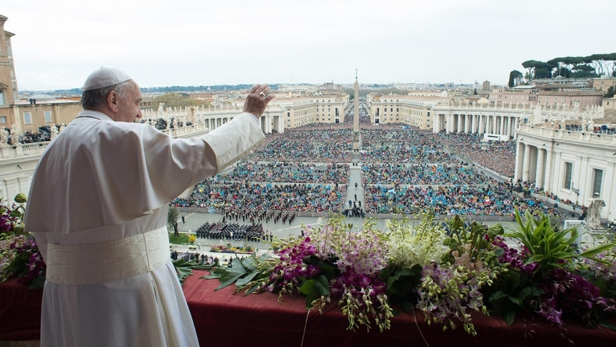 FILE - In this Sunday April 5, 2015 file photo, Pope Francis delivers the Urbi et Orbi (to the city and to the world) blessing at the end of the Easter Sunday Mass in St. Peter's Square at the Vatican. (AP Photo/L'Osservatore Romano, Pool, File)