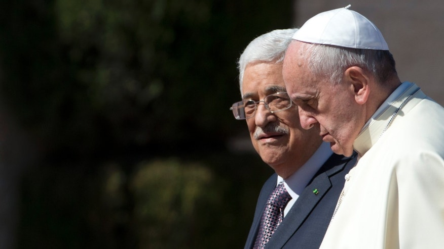 FILE - In this  Sunday, May 25, 2014 file photo Pope Francis is welcomed by Palestinian President Mahmoud Abbas upon his arrival to the West Bank city of Bethlehem. The Vatican officially recognized the state of Palestine in a new treaty finalized Wednesday, May 13, 2015 immediately sparking Israeli ire and accusations that the move hurt peace prospects. The treaty, which concerns the activities of the Catholic Church in Palestinian territory, makes clear that the Holy See has switched its diplomatic recognition from the Palestine Liberation Organization to the state of Palestine. (AP Photo/Andrew Medichini, Pool)