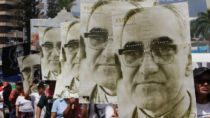 People march carrying portraits of Romero in San Salvador, El Salvador, in this March, 2011 file photo.