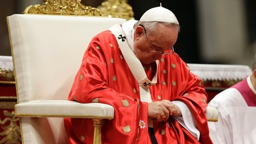 "Pope Francis celebrates a mass of Pentecost in St. Peter's Basilica, at the Vatican, Sunday, May 24, 2015. Pope Francis urged pilgrims filling St. Peter's Square on Pentecost Sunday to take ""the heroic examples"" of a slain El Salvadoran bishop and an Italian nun who worked in Kenya who were beatified this weekend. (AP Photo/Gregorio Borgia)"