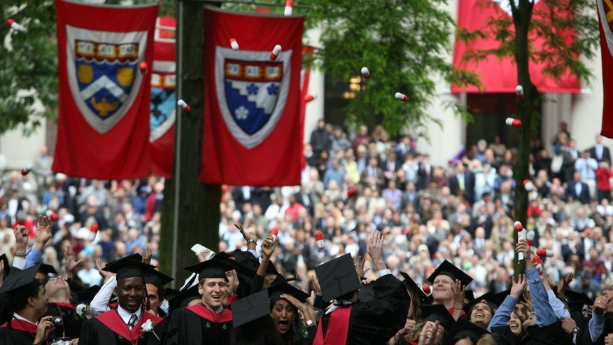 Harvard University Medical School graduates celebrate at commencement ceremonies by tossing giant pills in the air.
