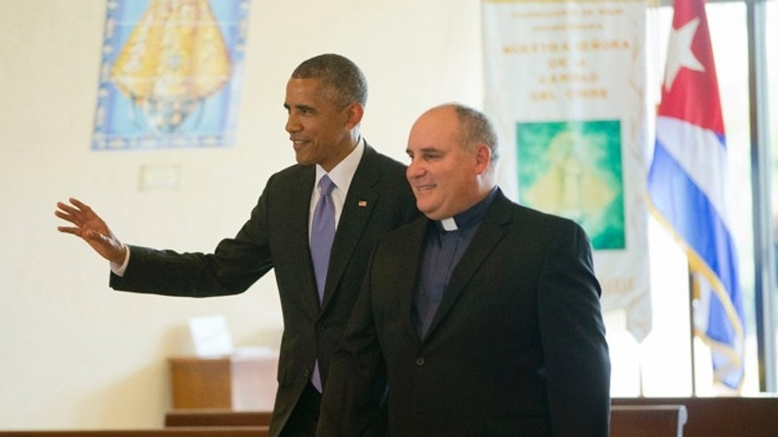 President Obama and Father Juan Rumin Dominguez at the Shrine of Our Lady of Charity Thursday, May 28, 2015.