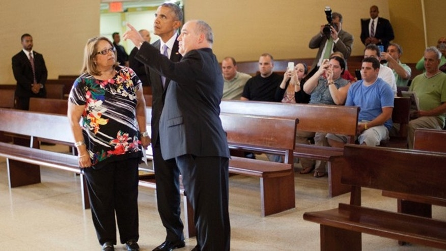 President Obama and Father Juan Rumin Dominguez at the Shrine of Our Lady of Charity on May 28, 2015.