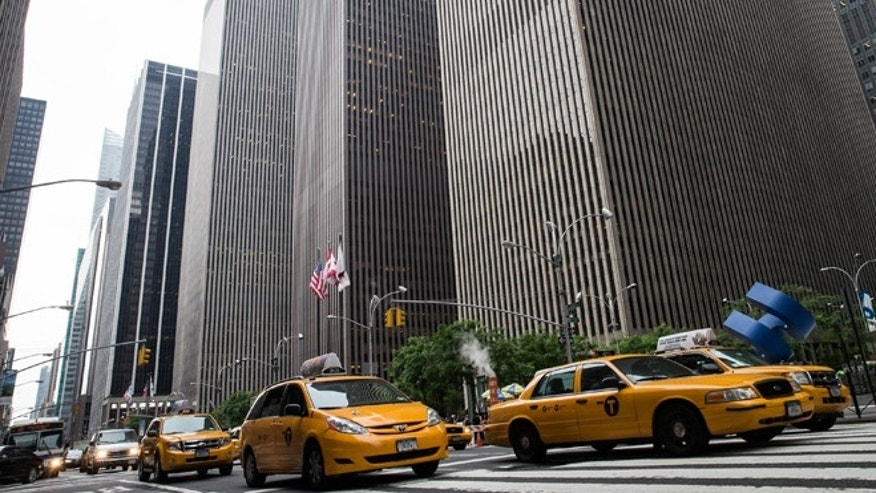"NEW YORK, NY - JUNE 18:  Taxies drive down Sixth Avenue, also known as ""Avenue of the Americas"" on June 18, 2013 in New York City. The prices for office space along sixth avenue, typically famous for being some of the most expensive real estate in New York, have been falling recently.  (Photo by Andrew Burton/Getty Images)"